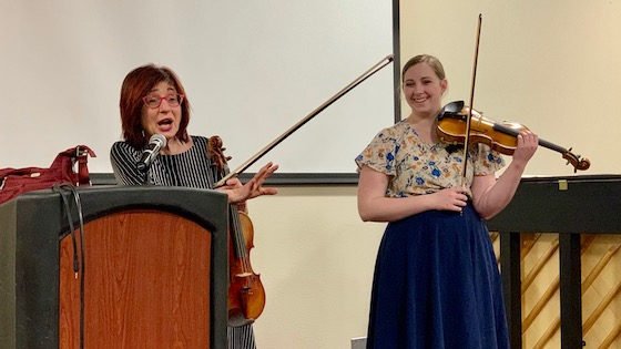 Mimi Zweig and violinist Holly Sidney