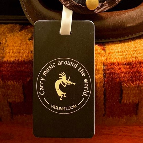 V.com luggage tag