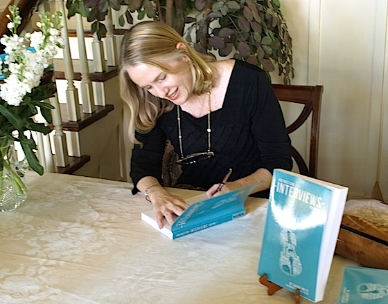 Laurie signing at the book party